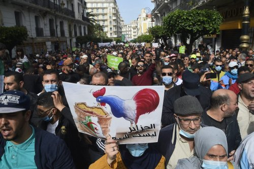 Algerians shout anti-France slogans during an anti-government demonstration in the capital Algiers on 9 April 2021. [RYAD KRAMDI/AFP via Getty Images]
