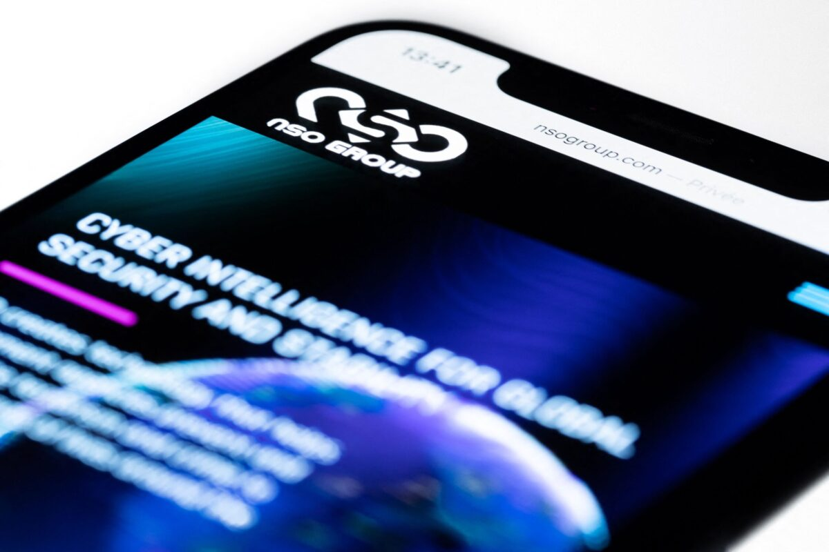 This studio photographic illustration shows a smartphone with the website of Israel's NSO Group which features 'Pegasus' spyware, on display in Paris on July 21, 2021. - Private Israeli firm NSO Group has denied media reports its Pegasus software is linked to the mass surveillance of journalists and rights defenders, and insisted that all sales of its technology are approved by Israel's defence ministry (Photo by JOEL SAGET / AFP) (Photo by JOEL SAGET/AFP via Getty Images)