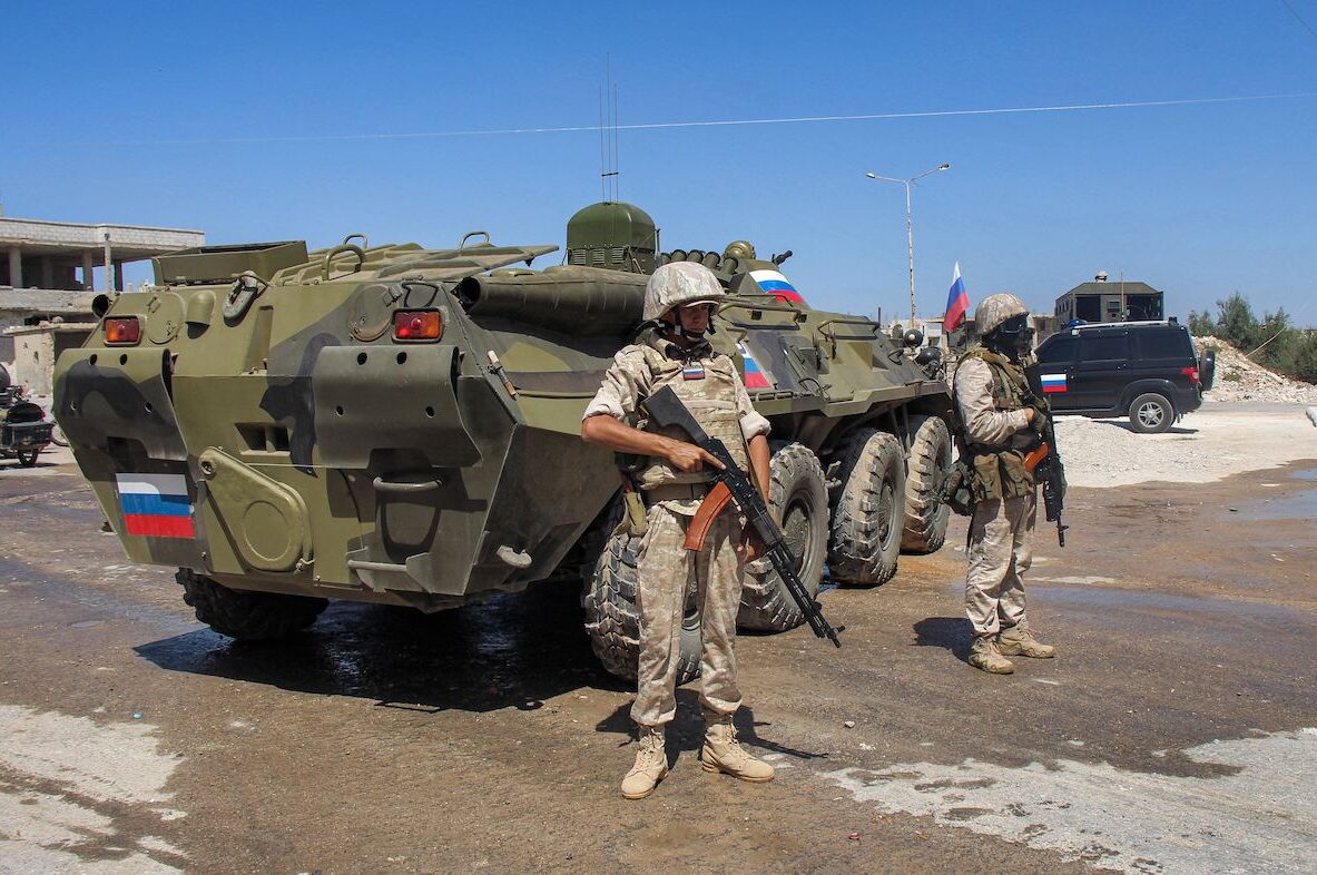 Russian soldiers stand by an armoured personnel carrier (APC) in the Syrian rebel-held Daraa al-Balad district of the southern city of Daraa on 6 September 2021 [SAM HARIRI/AFP via Getty Images]