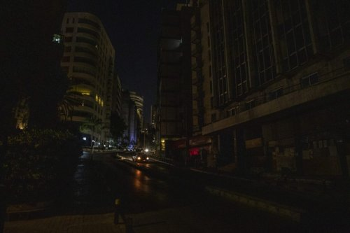 A street in darkness during a power cut at night in Beirut, Lebanon, on Tuesday, September 7, 2021 [Francesca Volpi/Bloomberg via Getty Images]