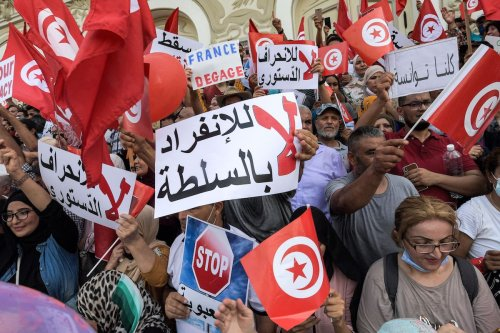 Demonstrators chant slogans during a protest in Tunisia's capital Tunis on 26 September 2021, against President Kais Saied's recent steps to tighten his grip on power. [FETHI BELAID/AFP via Getty Images]