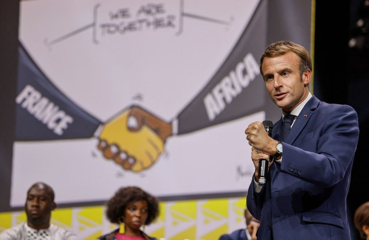 """French President Emmanuel Macron speaks during the plenary session of the """"Africa-France"""" Summit in Montpellier, southern France, on 8 October 2021. [LUDOVIC MARIN/AFP via Getty Images]"""