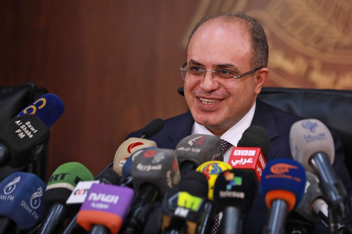 Syrian Minister of Economy and Foreign Trade Mohammad Samer al-Khalil gives a press conference in Damascus on 13 October 2021. [LOUAI BESHARA/AFP via Getty Images]