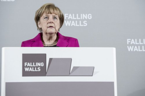 Then-German Chancellor Angela Merkel delivers a speech during the opening reception to the 2014 Falling Walls Conference at the Neue Nationalgalerie on November 8, 2014 in Berlin, Germany [Michael Ukas/Pool/Getty Images]