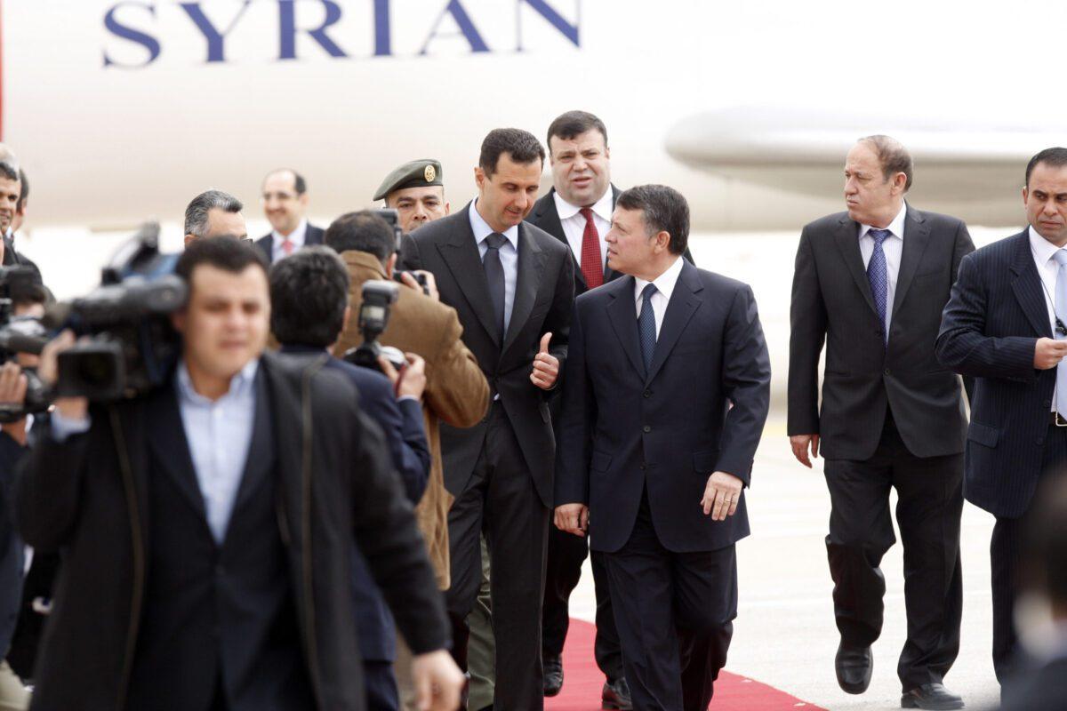 Syrian President Bashar al-Assad (L) is received by Jordan's King Abdullah II (R) upon his arrival on March 20, 2009 in Amman, Jordan [Salah Malkawi/Getty Images]