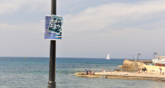 Sign With a View of The Med