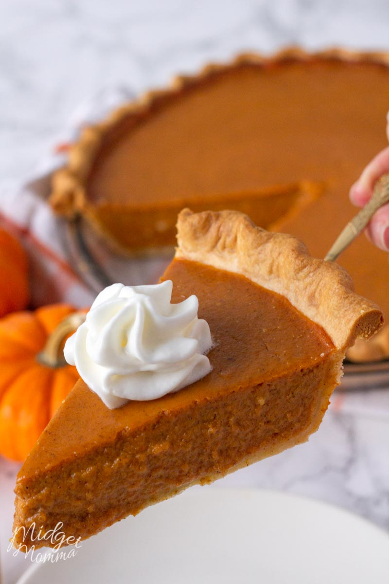 pumpkin pie from scratch topped with whipped cream