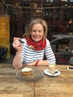 Midlife woman eating cake