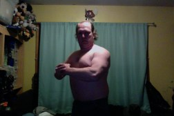 Week 1 of 15 WHG training. Shirtless, flexed. And looking fairly silly doing it.