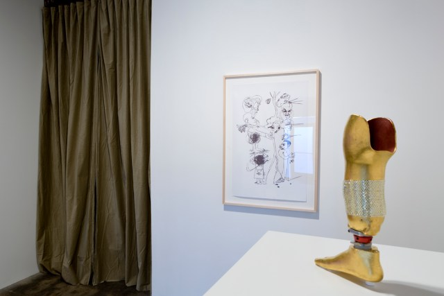For Rent, installation view. Left: Untitled, 2007. Ball point pen on paper. Right: Untitled, 2007. Gilded prosthesis with Swarovski crystals.
