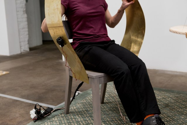 Chair with Wings, detail, 2016. Chair, brass, transducer, amp, mp3 player, touch sensor, arduino, and audio repeater. 57 x 20 x 31 inches.
