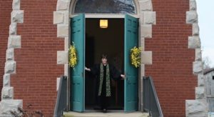 Pastor McColl opening front doors of church in Welcome