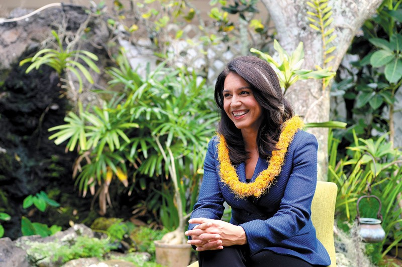 Tulsi Gabbard in the backyard of her Kailua home