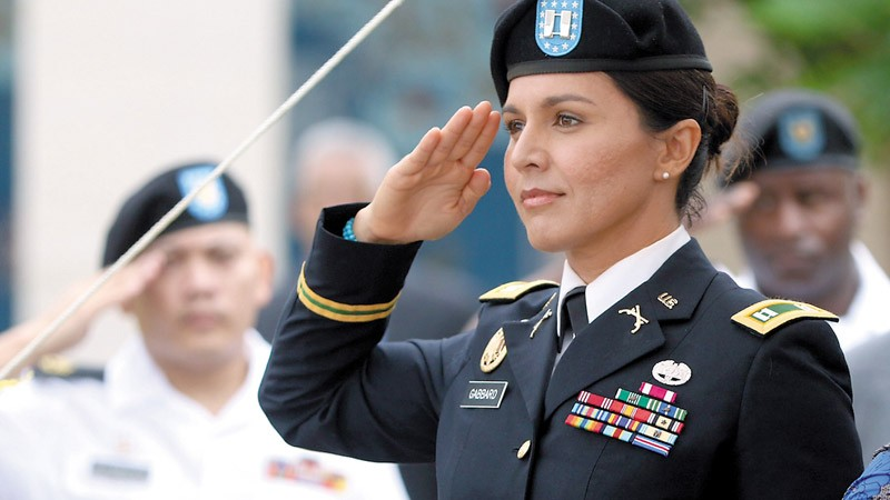 Maj. Tulsi Gabbard salutes the flag at the National Memorial Cemetery of the Pacific (Punchbowl) PHOTOS COURTESY TULSI GABBARD