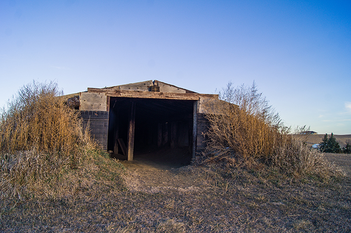 Built from sod and railroad ties, the reconstructed shelter serves as a memory of what occurs when mass hysteria grips a community.