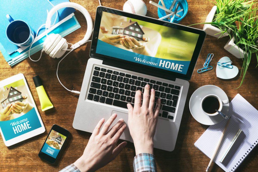 Real estate website mock up on laptop screen, tablet and smartphone