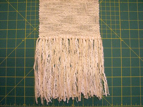 Untrimmed fringe on a handwoven scarf.