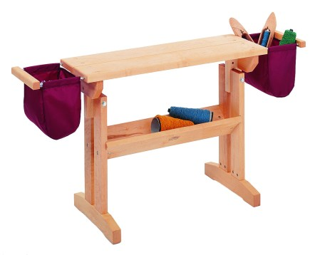 Schacht Loom Bench, shown with optional bench bags, sold separately.