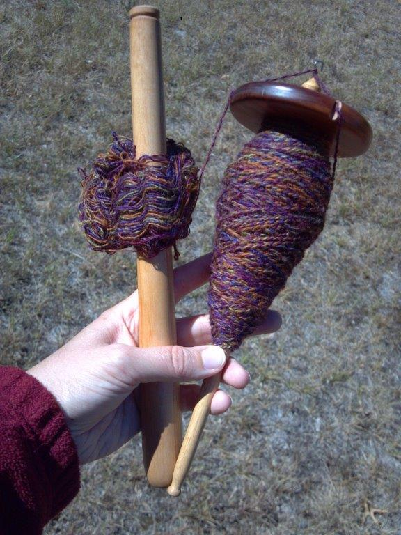 Beehive cop on spindle while plying