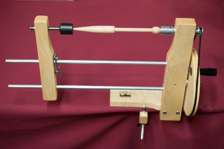 Tapestry bobbin in the Hand Winder with lace tips.