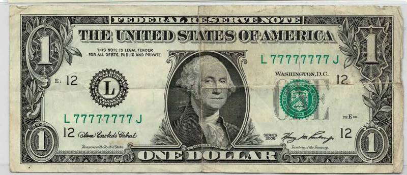 dollar bill with a solid 7's fancy serial number