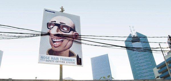 Il divertente cartellone pubblicitario di un rasoio per peli del naso