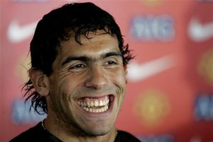 New Manchester United signing Argentina international Carlos Tevez smiles during a press conference at the club's Carrington training ground, Manchester, England, Monday Aug. 13, 2007. (AP Photo/Dave Thompson) ** NO INTERNET/MOBILE USAGE WITHOUT FAPL LICENCE - SEE IPTC SPECIAL INSTRUCTIONS FIELD FOR DETAILS **