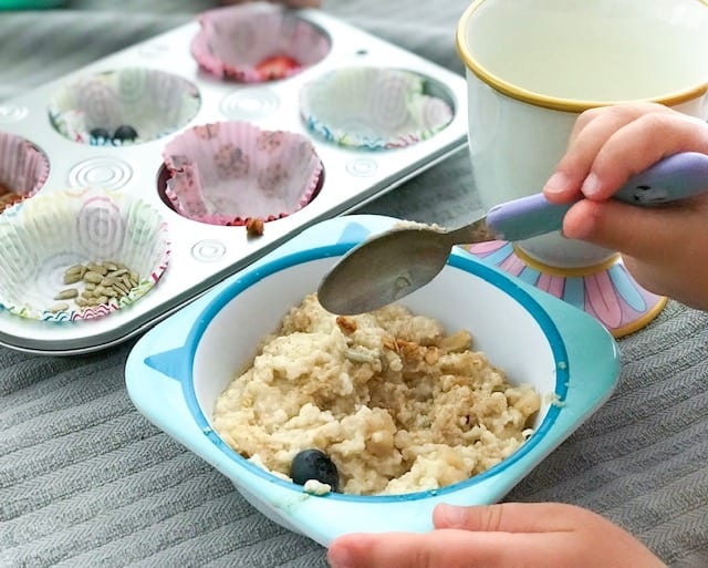 A bowl of oatmeal with a muffin tin