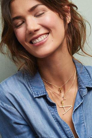 """happy woman with letter """"A"""" necklace"""