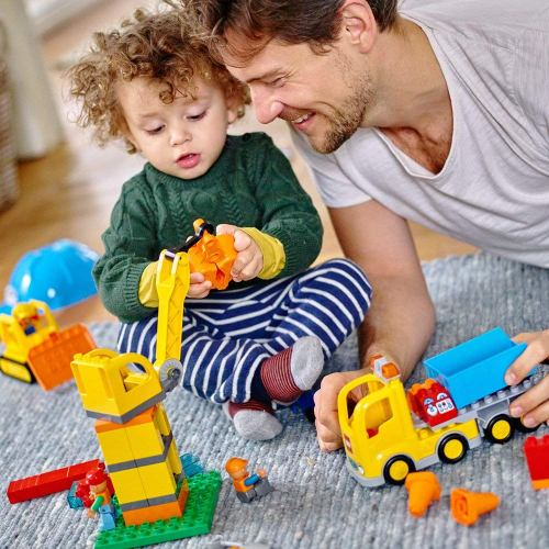 A dad playing lego duplos with his father