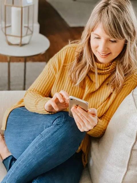 blonde woman using Migraine Healthline App