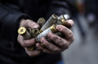 An anti-government protester shows empty bullet casings used by Ukrainian riot police against demonstrators in central Kiev.