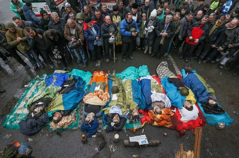 Activists pay respects to protesters killed in clashes with police in Kiev, Ukraine.
