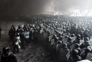 Riot police officers gather as they clash with protestors in Kiev on Jan. 22, 2014.