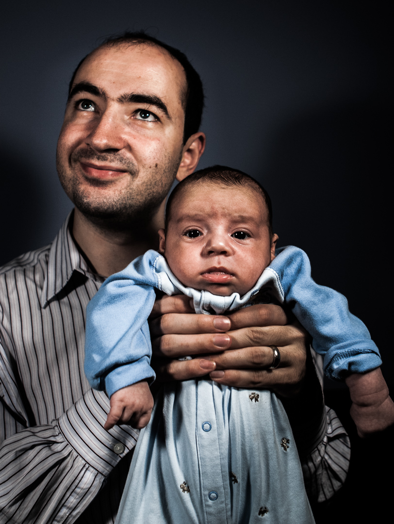 Father, Vladimir Khavulya, holding his son, Ari Khavulya. Brooklyn, NY. Model releases available.