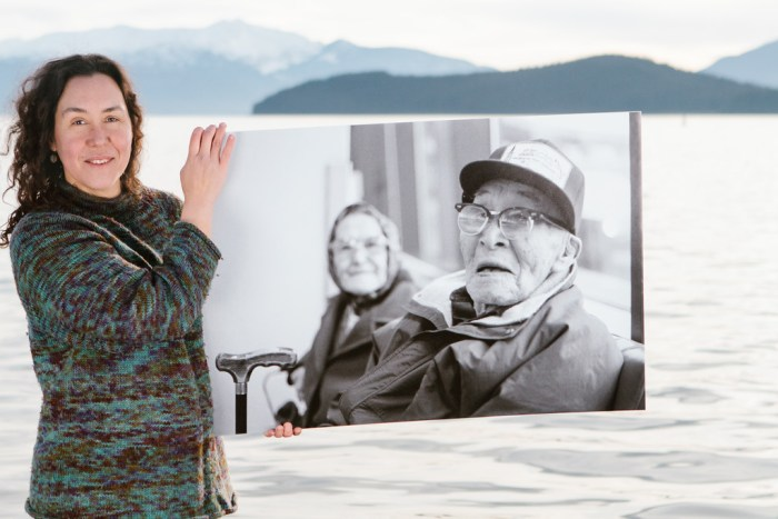 Melanie Brown with a photo of her great-grandparents, Anna and Paul Chukan