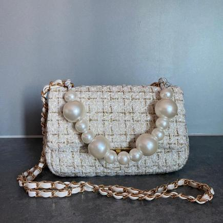 a vibe white pearls hand bag