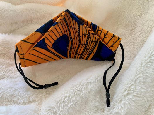Same mask from inside view. The nose flap is fully visible, so are the two black elastic adjustable straps.