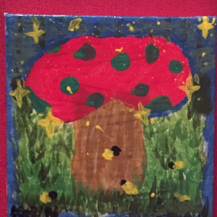 A red mushroom with blue dots surrounded in a field with yellow stars about.