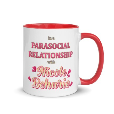 """White, ceramic mug with graphic, 11 oz. ceramic mug with Red color inside and Red handle. Colorful typographic art reads, """"in a parasocial relationship with Nicole Beharie."""""""