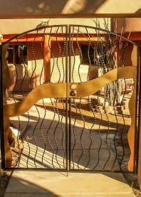 Close up- Bent twisted metal with gold sheet metal accents -RV Gate
