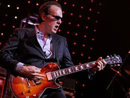 Joe Bonamassa on stage with guitar