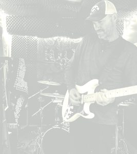 Mike Echlin in studio on electric guitar