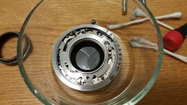 The shutter during it's Ronsonol bath. I recommend leaving the chrome speed selector ring on while cleaning the shutter.