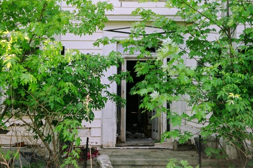 This is the front entrance to an abandoned farmhouse near my work. Creepy.