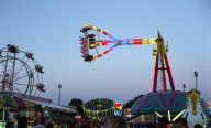 Shot wide open at 1/125. There is no motion blur in the carnival ride.