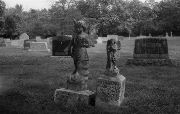 Im torn between the beauty of these children's headstones, but saddened at the thought of a child dying so young.