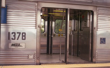 The reflections in the metal doors of a Metra train show incredible detail.