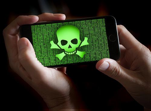 Skull and crossbones on phone screen