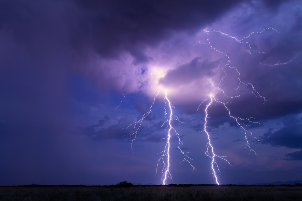 These two bolts almost appear to be mirror images of each other at first glance. Of course they are very different...but it's what fun about lightning photography. Finding the hidden shapes and nuances to what you capture.